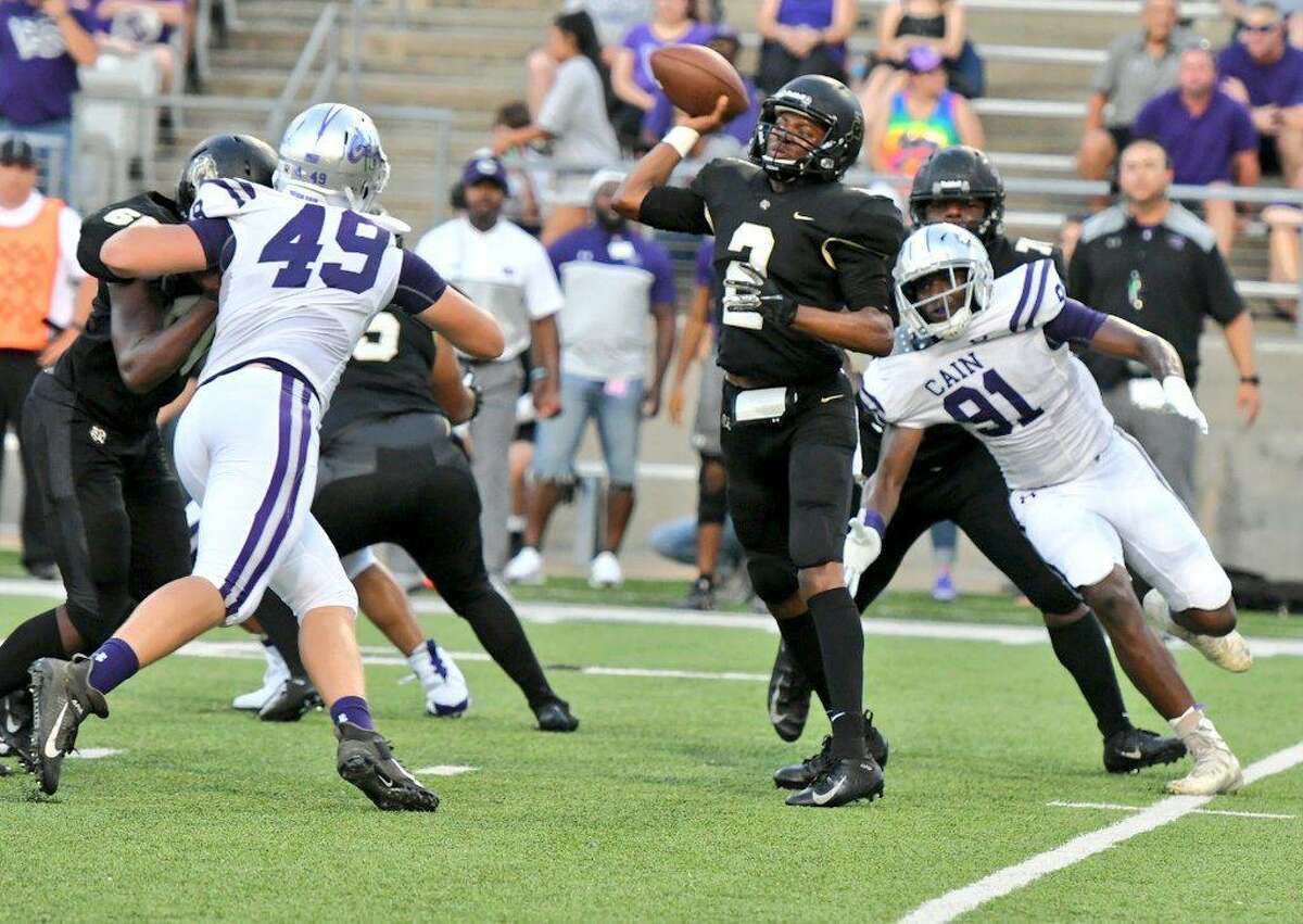 Cy-Park's Michael Tolbert attempts a pass vs. Cy Park in non-district play, Aug. 29, at Cy-Fair FCU Stadium.