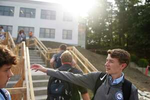 Sophomore John Breitfelder points out features of the new campus on the first day of school at Greenwich Country Day School Upper School in Greenwich, Conn. Wednesday, Sept. 4, 2019. GCDS welcomed students its impressive new Upper School campus on the grounds of the former Stanwich School campus.