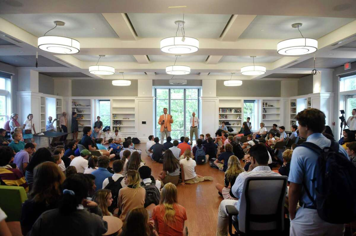 GCDS Headmaster Adam Rohdie, left, and GCDS Head of Upper School Chris Winters speak with students on the first day of school at Greenwich Country Day School Upper School in Greenwich, Conn. Wednesday, Sept. 4, 2019. GCDS welcomed students its impressive new Upper School campus on the grounds of the former Stanwich School campus.