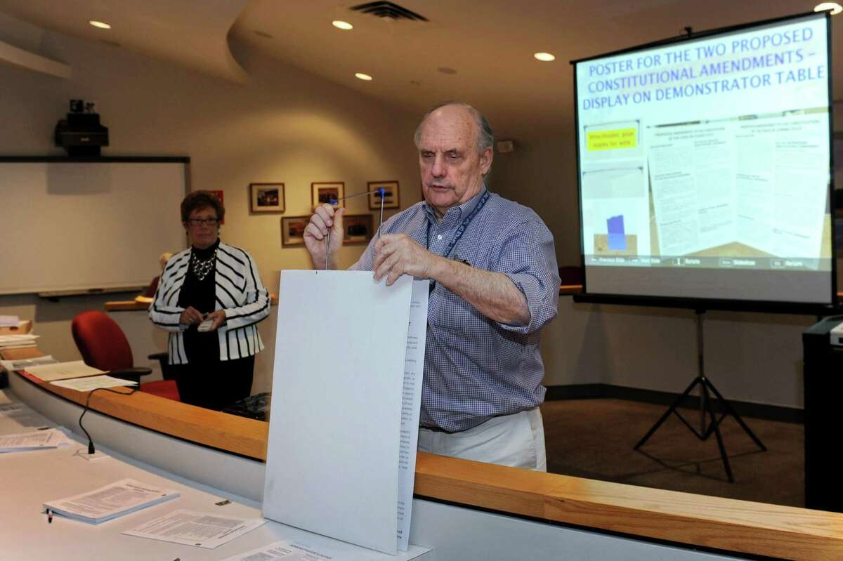 Norwalk Democratic Registrar of Voters, Stuart Wells, trains poll workers Tuesday, October 23, 2018, in Norwalk, Conn. The Registrar of Voters' computers will be upgraded to meet the new election security requirements from the state.