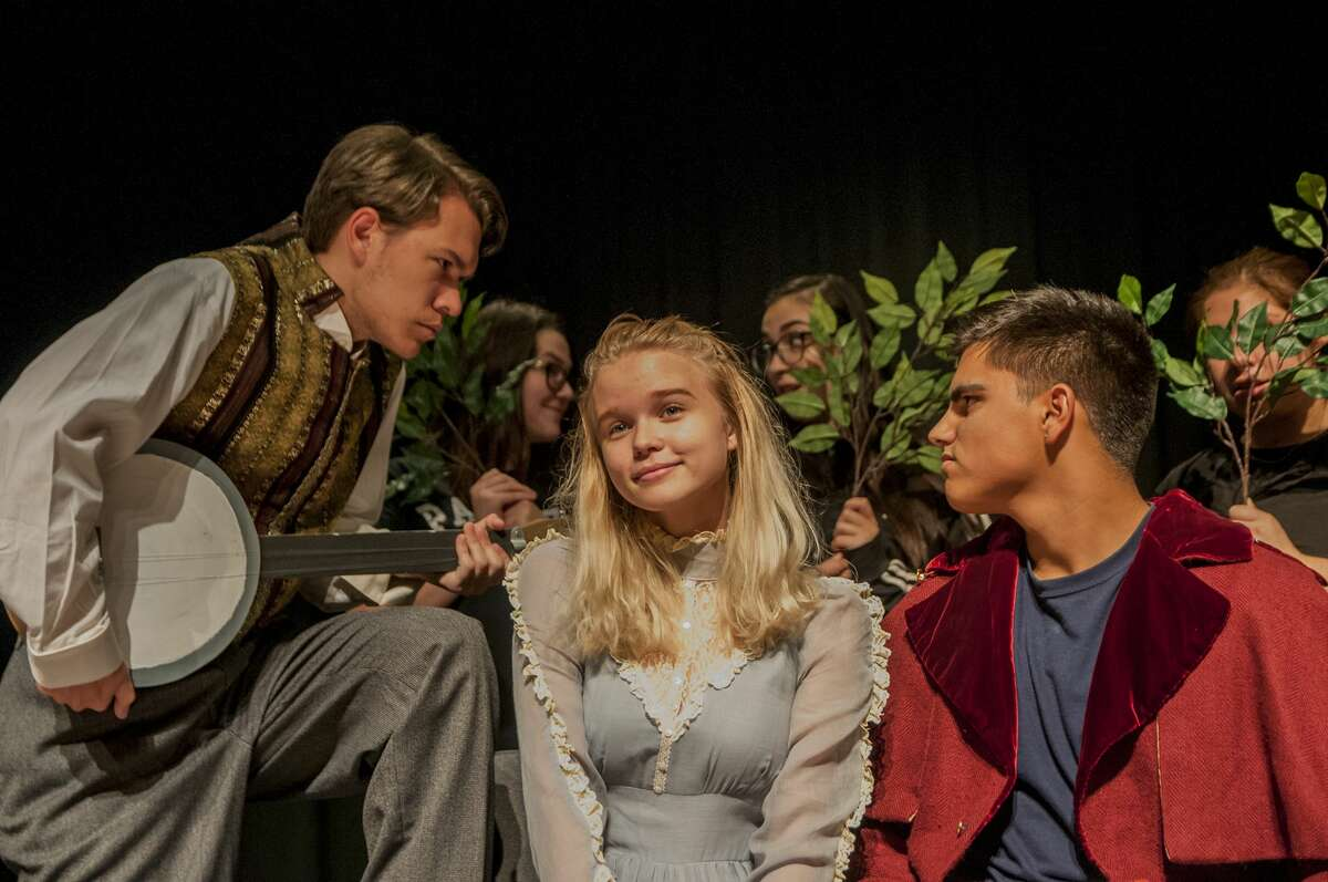 Nick Keel as Hortensio uses a banjo to serenade Erin Maslonka as Bianca in Dobie Theatre's production of Shakespeare's