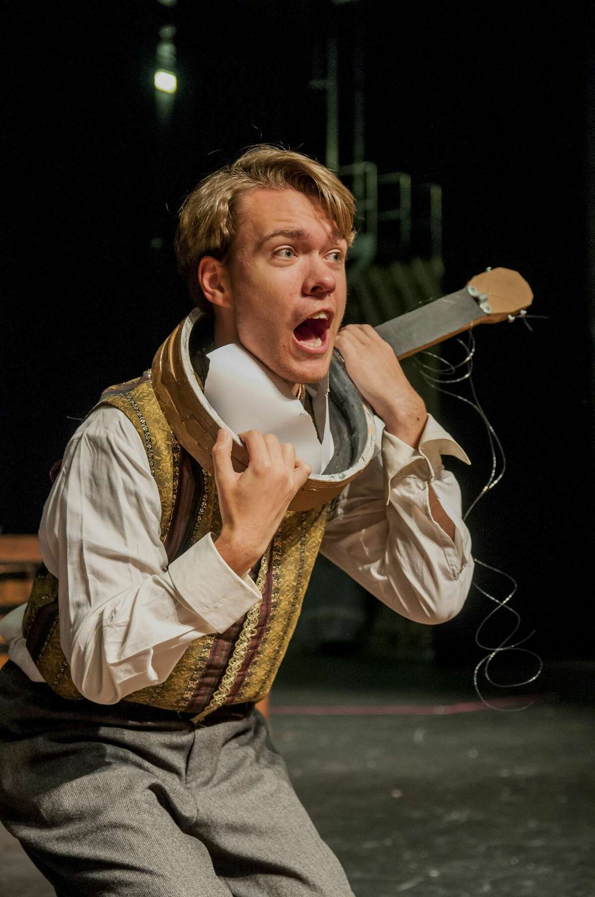 Nick Keel as Hortensio winds up wearing a musical instrument in Dobie Theatre's production of