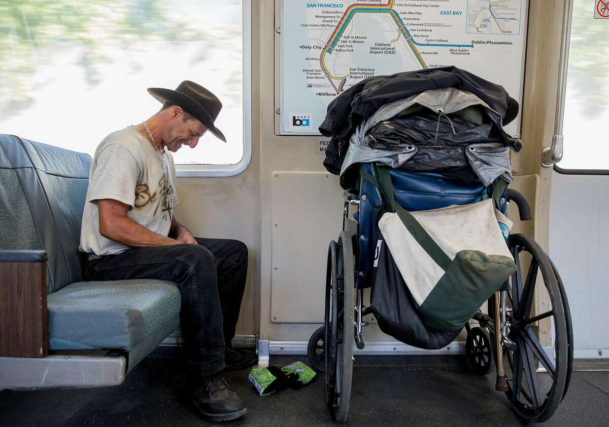 Joe Dennis, 55, of Fremont rides the Antioch BART train with his belongings in Walnut Creek, Calif. Tuesday, September 3, 2019.