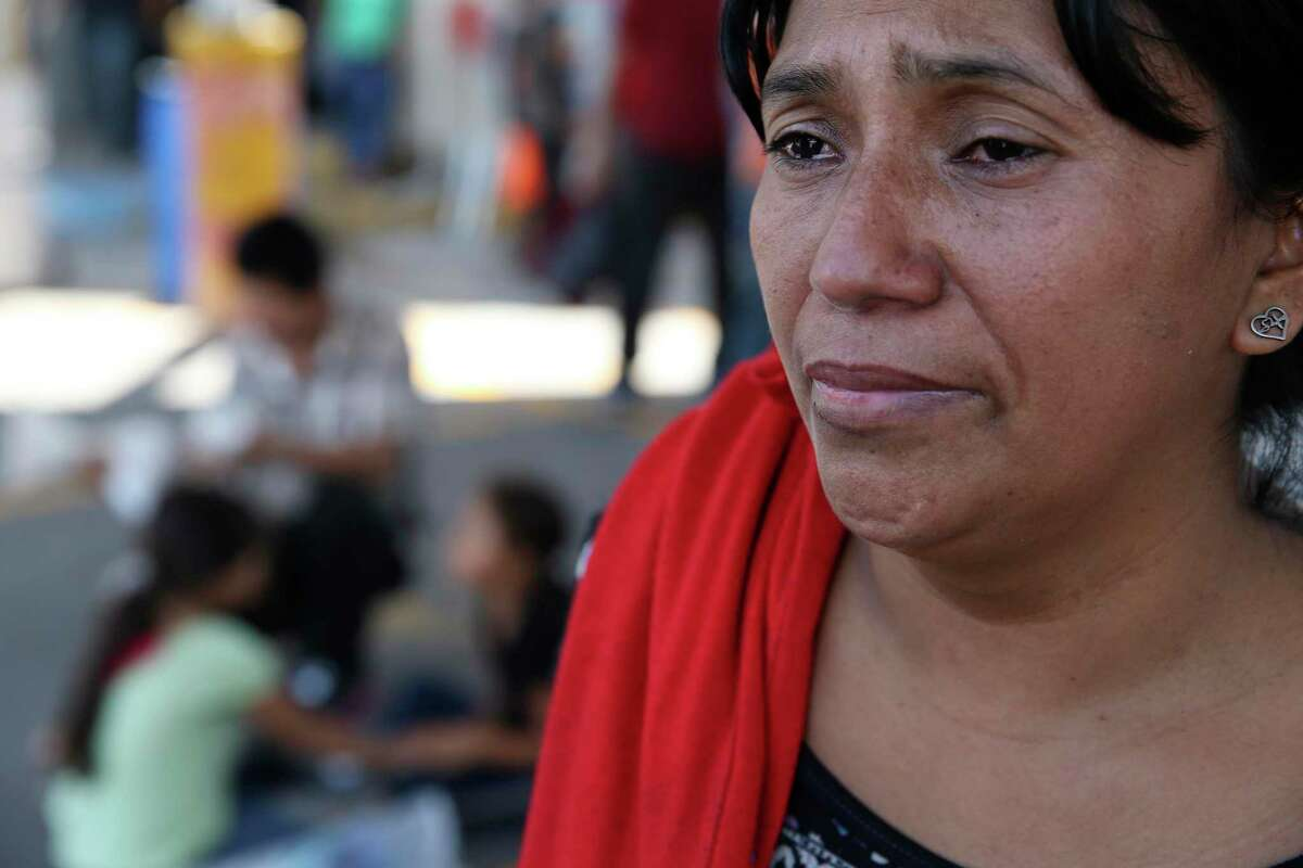 Honduran migrant Sandra Galeano, 38, talks about her ordeal as she shelters by Mexican Immigration offices at International Bridge No. 1 in Nuevo Laredo, Mexico on Thursday, Aug. 15, 2019. Mostly Central American migrants were sheltered at the place after they crossed into the U.S. seeking asylum but were sent back to Mexico under the Migrant Protection Protocols.