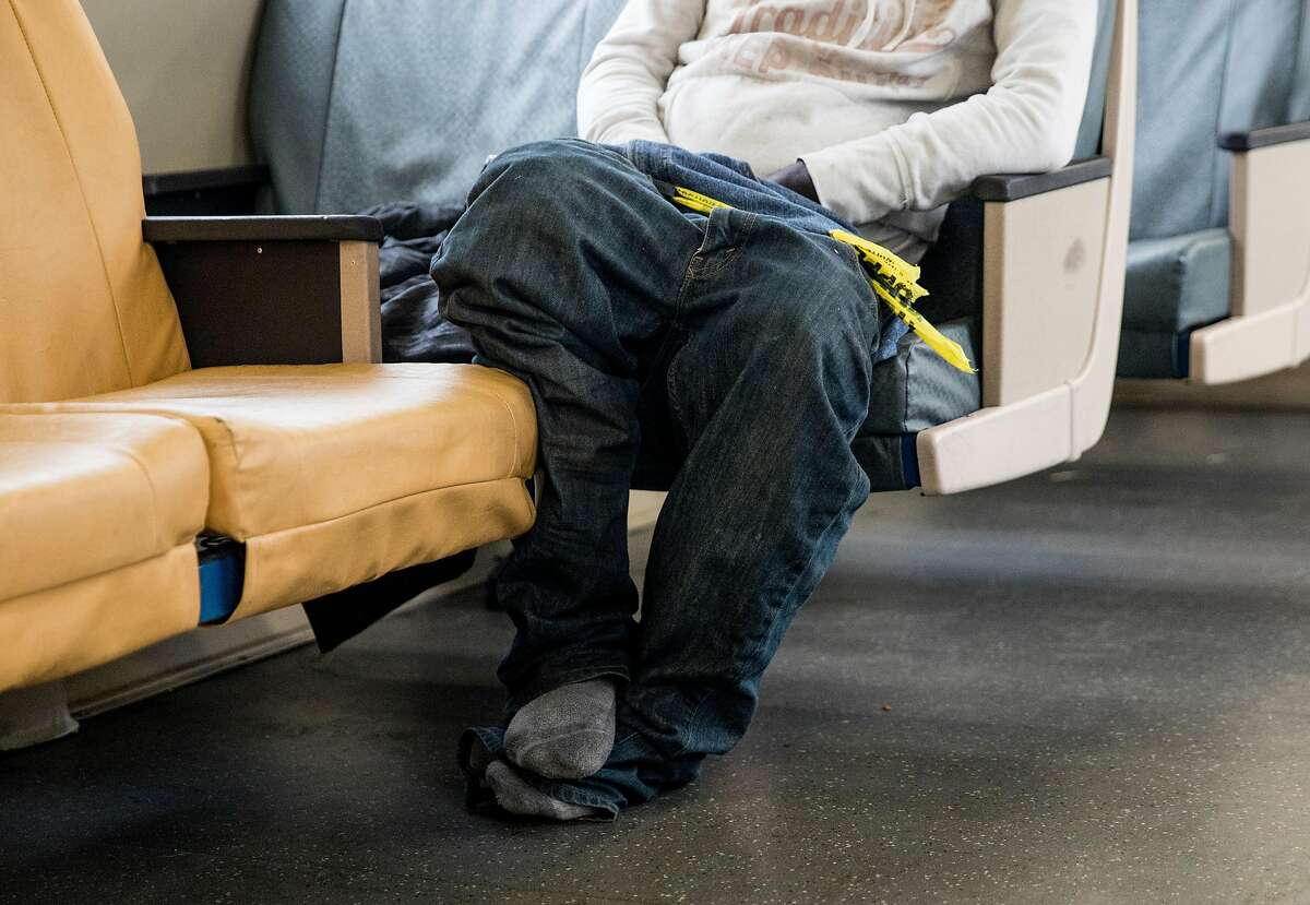 Roy Thomas, 68, of Oakland sleeps on a Richmond bound BART train in El Cerrito, Calif. Tuesday, September 3, 2019.