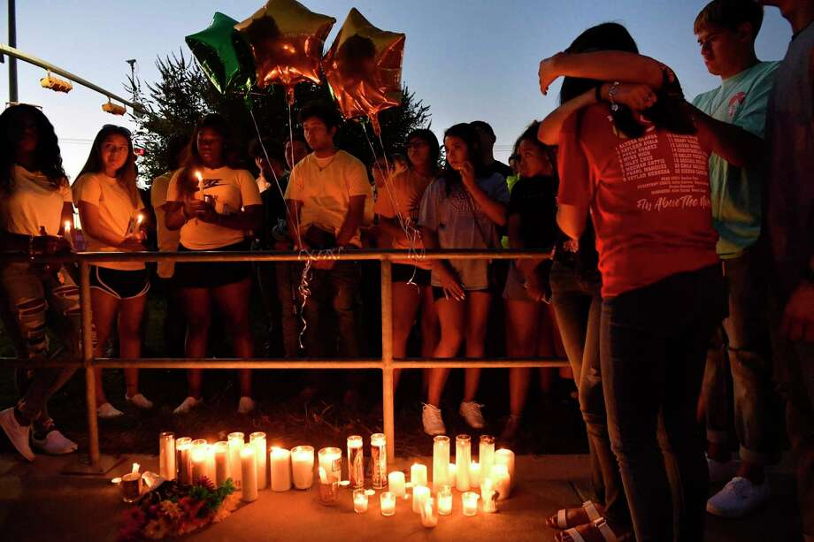 Odessa High School students and families gather to remember 15 year-old Leilah Hernandez, who was killed in Labor Day's shooting spree. How many more tragedies and memorials must we witness before state leaders act? Photo: Ronald W. Erdrich /Associated Press / Abilene Reporter-News