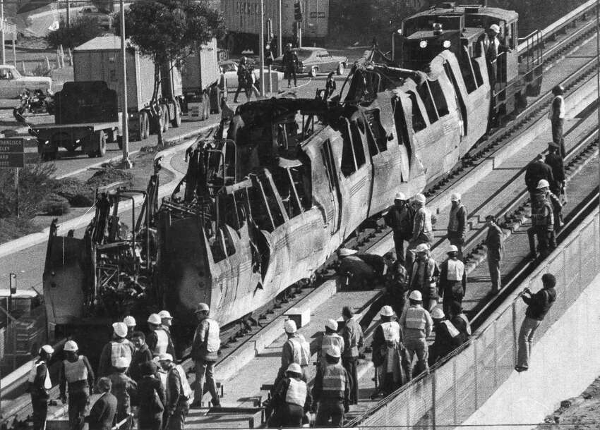 The scorched shells of two fire-damaged BART cars from train No. 117 are pulled out of the Transbay Tunnel on Jan. 18, 1979, a day after it caught fire about a mile from the tunnel's eastern entrance.