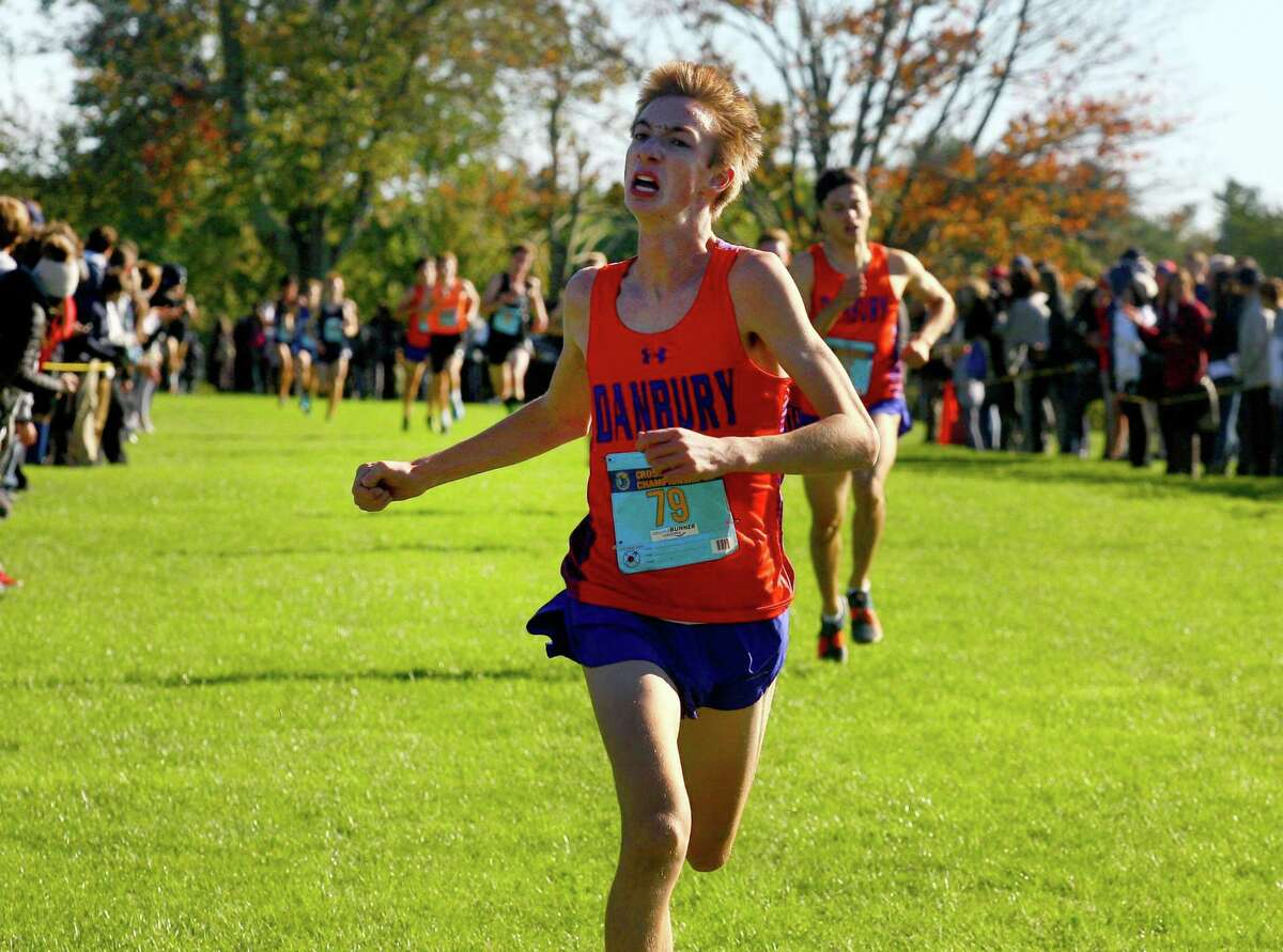 Danbury's Jack Watson approaches the finish line during FCIAC Boys Cross Country Championship race action at Wavenly Park in New Canaan, Conn. on Thursday Oct. 18, 2018.