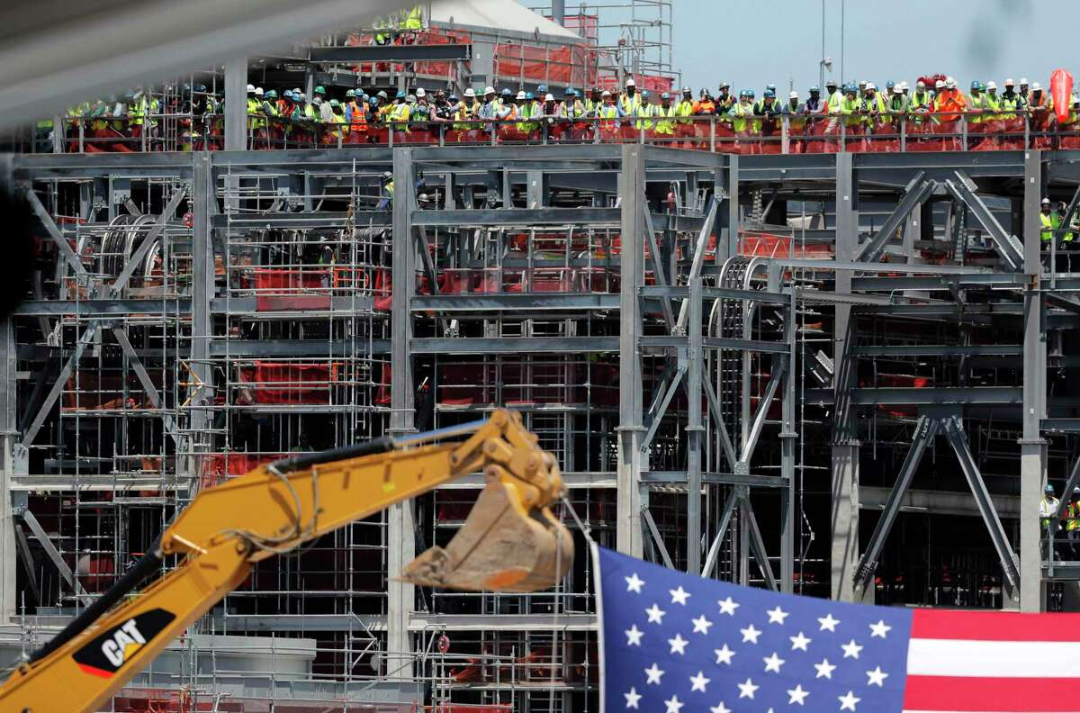 Workers stand and wait for President Donald Trump to arrive at the Cameron LNG Export Terminal in Hackberry, La., in May. Governments in Europe and across the globe are coming under increasing pressure to buy American LNG from the Trump administration.