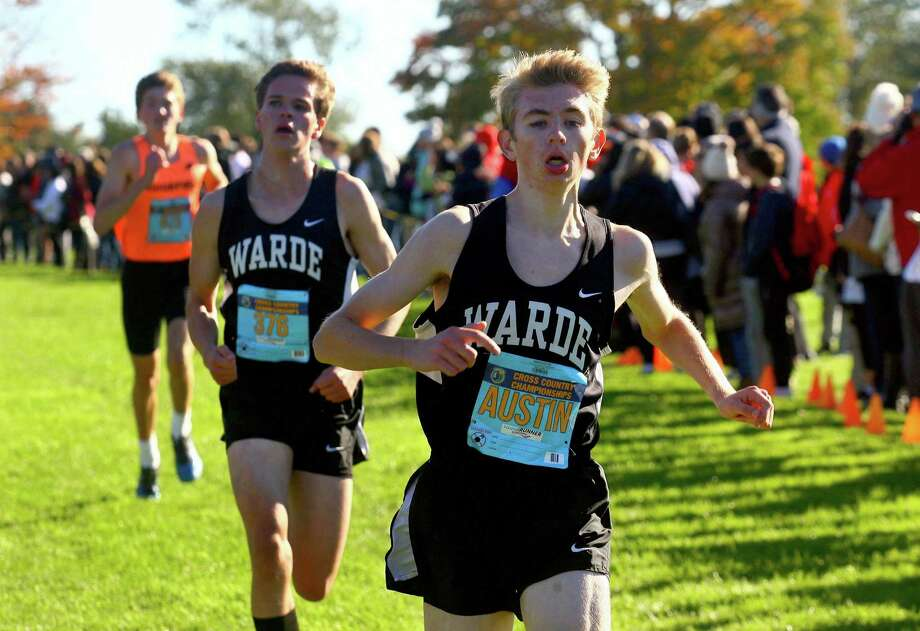Fairfield Warde's Austin Hutchens reaches the finish line during the FCIAC championship last season. Photo: Christian Abraham / Hearst Connecticut Media / Connecticut Post
