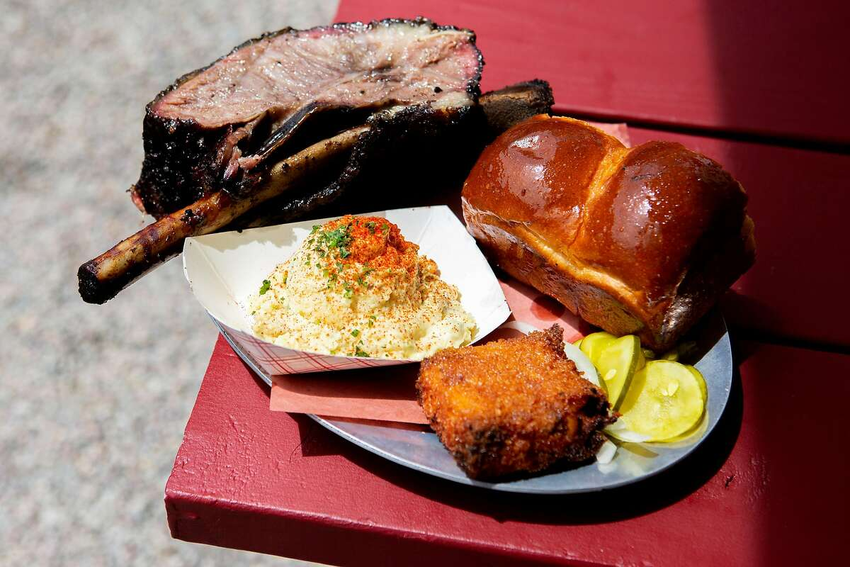The Beef Rib (with side of pickles, sliced sweet Vidalia onion, and parker house rolls), potato salad, and frankaroni (crispy fried mac and cheese with hot dog inside) at 4505 Burgers & BBQ on Saturday, June 29, 2019, in Oakland, Calif. The new restaurant is located at 3506 MacArthur Blvd.