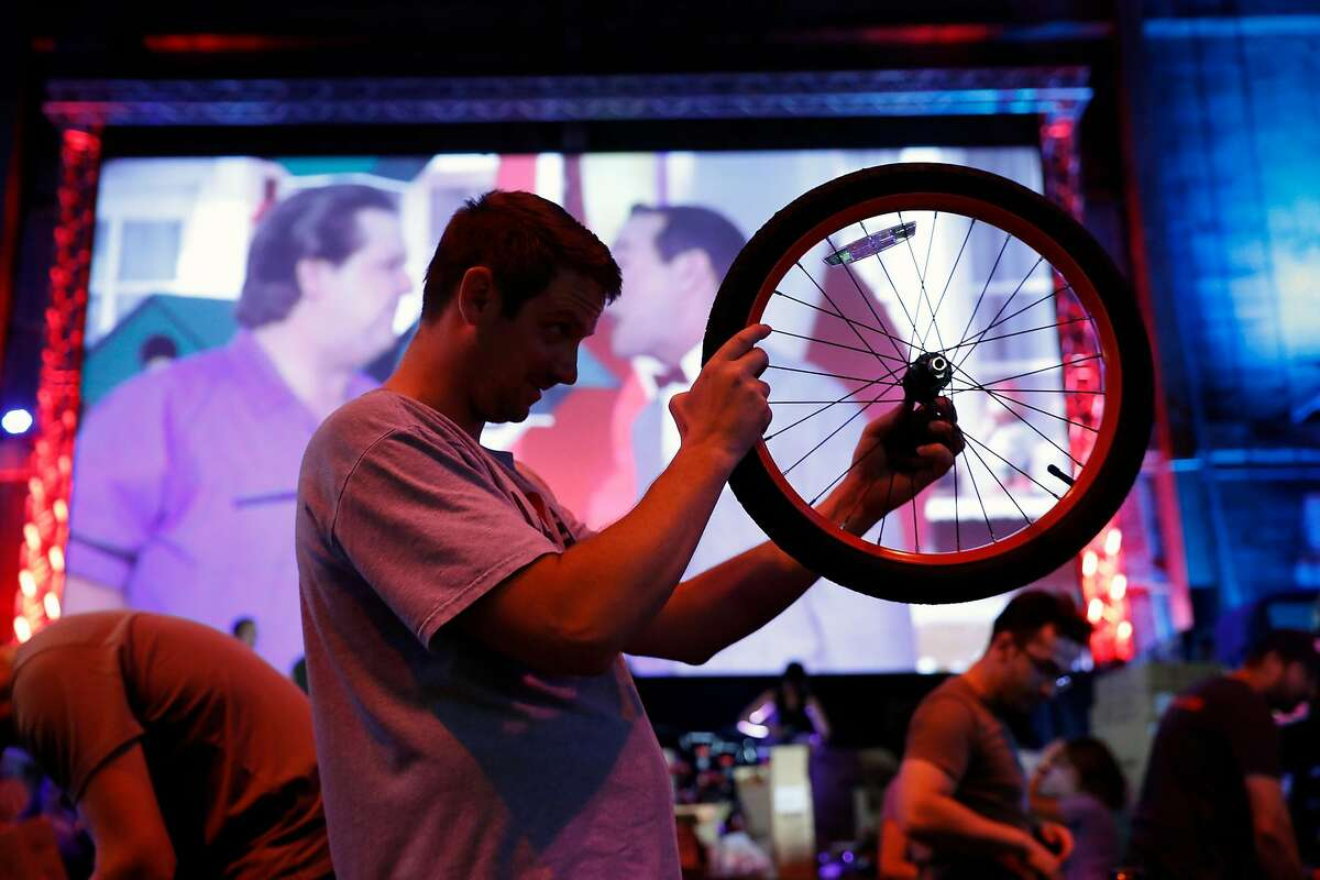Andrew Kavanah helps build bikes for students at McCoppin Elementary School at Emporium Arcade Bar in San Francisco, Calif., on Tuesday, September 3, 2019.