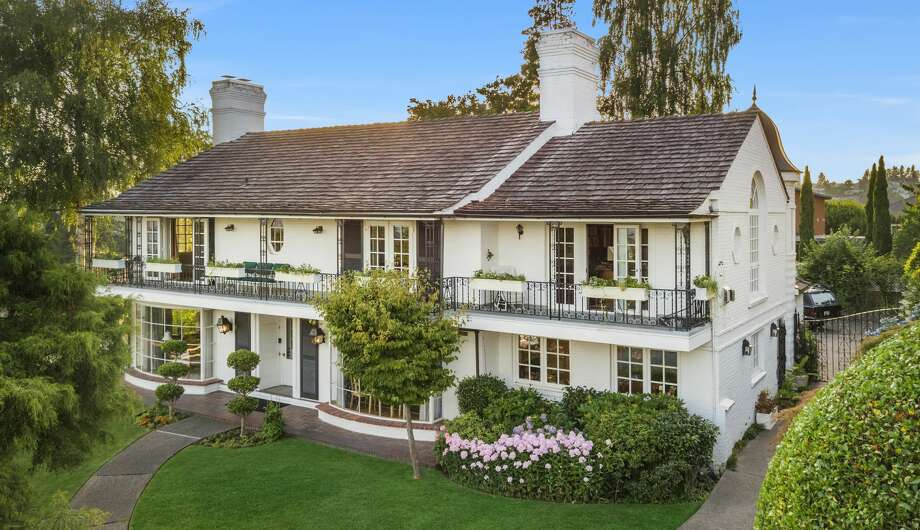 With decades of illustrious charm and a stunning overlook, this Windermere home asks $3.875M Photo: Amaryllis Lockhart With Clarity NW Photography
