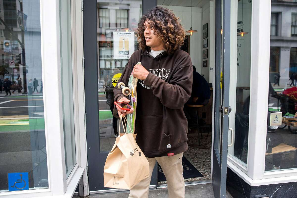 Postmates courier,Tony Martinez, picks up lunch order at Luke's Lobster restaurant. Tuesday, May 21, 2019. San Francisco, Calif.