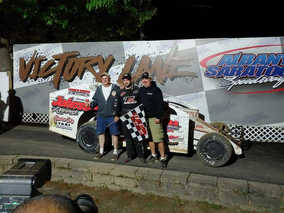 Driver Marc Johnson, center, with Andy Sandstrom, right, and Scott Saunders. (Courtesy photo) Photo: Courtesy Photo