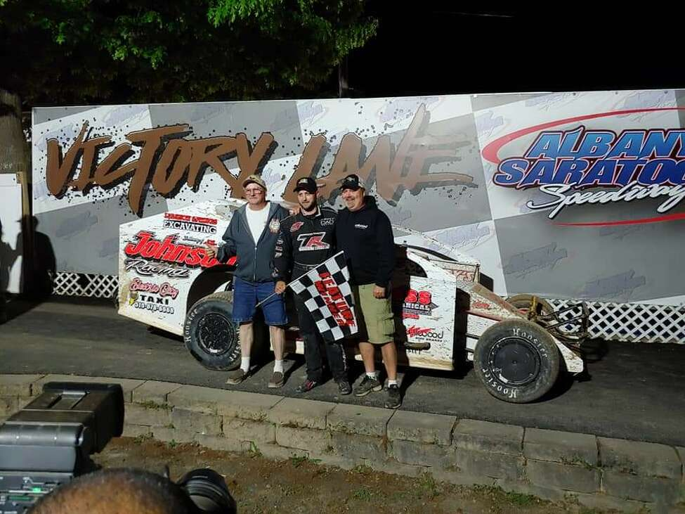Driver Marc Johnson, center, with Andy Sandstrom, right, and Scott Saunders. (Courtesy photo)