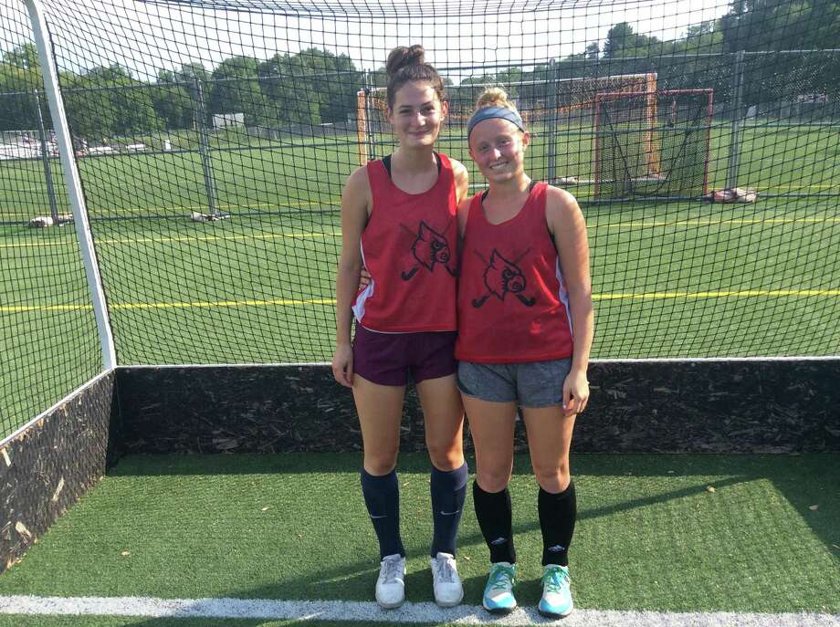 Katie Piotrzkowski, left and Ashley Zolin are senior captains on the Greenwich High girls field hockey team. Photo: David Fierro /Hearst Connecticut Media