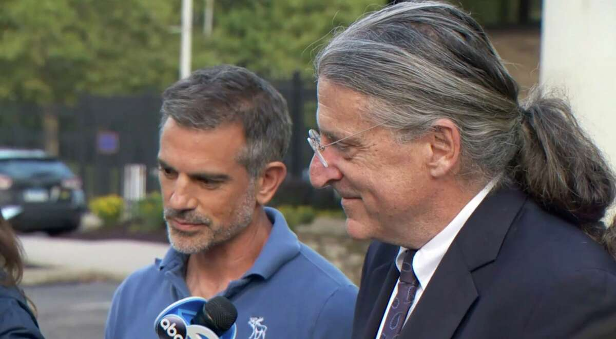 An image from a WTNH webcast showing Fotis Dulos and lawyer Norm Pattis outside the Troop G state police barracks in Bridgeport after Dulos' arrest Sept. 4, 2019.
