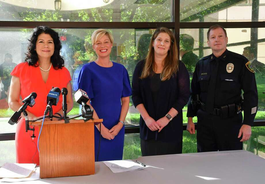 On Wednesday, Sept. 4, at the UTHealth Harris County Psychiatric Center, Texas Sen. Carol Alvarado (from left), Texas Rep. Sarah Davis, UTHealth Houston Pediatric Psychiatrist Elizabeth Newlin, MD, and Houston Police Department Assistant Chief Jim Jones pause for a photo after discussing Texas Senate Bill 20, which is set to provide $15 million in grants for helping child survivors of sex trafficking. Photo: Photo ByDwight Andrews/UTHealth / McGovern Medical School at UTHealth Office of Communications 6431 Fannin Street, B.340