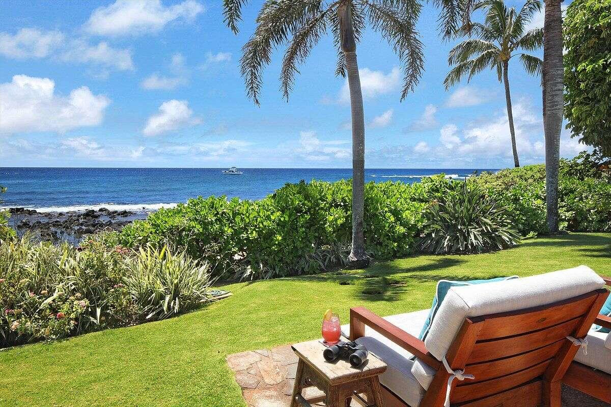 The home sits directly on Poipu Beach.