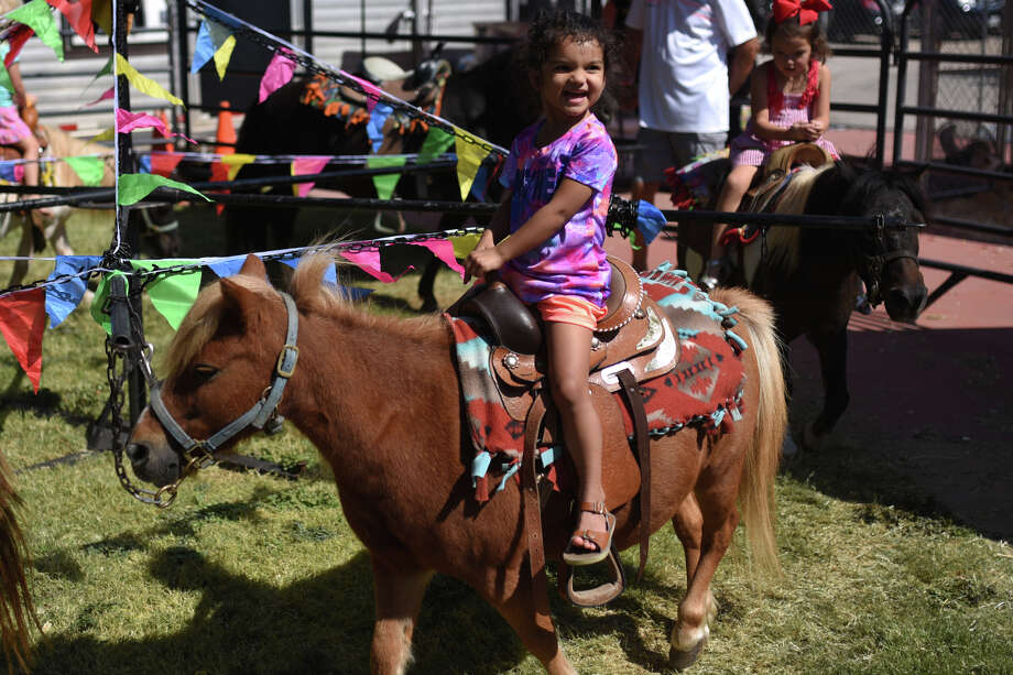 Septemberfest attendees ride ponies Sept. 9, 2017, at the Museum of the Southwest. James Durbin/Reporter-Telegram Photo: James Durbin / © 2017 Midland Reporter-Telegram. All Rights Reserved.