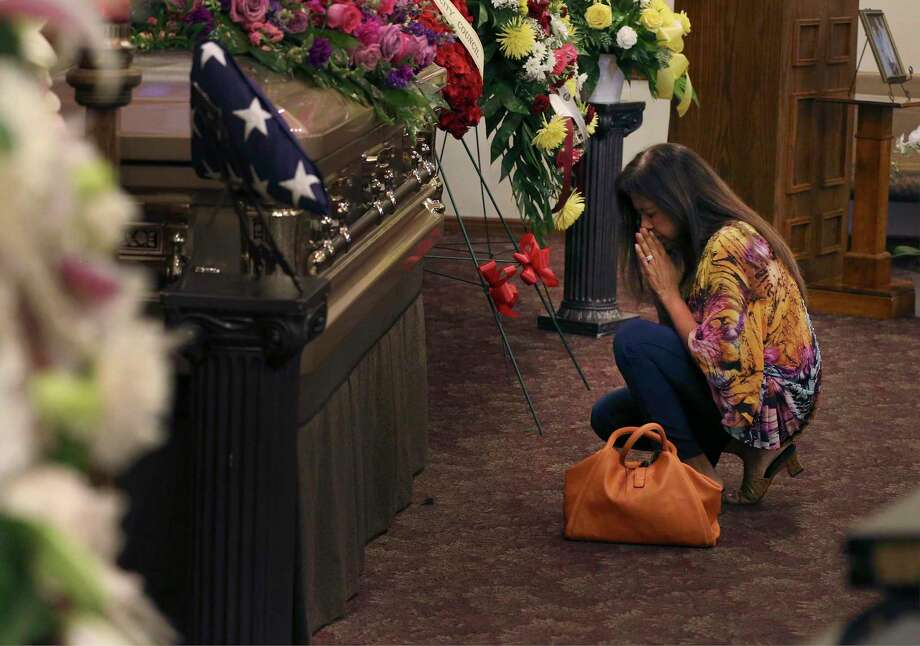 Sandra Torres Richardson kneels to pray by the casket of Lila Cockrell as San Antonians from all walks of life gather for a visitation service at Mission Park Funeral Chapel to pay homage and to celebrate the life of the former mayor on Tuesday, Sept. 3. San Antonio will say a final goodbye Thursday to Lila Cockrell, the city's first female mayor, during a memorial service and a tribute to her legacy. Both are open to the public. Photo: Kin Man Hui /Staff Photographer / ©2019 San Antonio Express-News