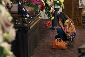 Sandra Torres Richardson kneels to pray by the casket of Lila Cockrell as San Antonians from all walks of life gather for a visitation service at Mission Park Funeral Chapel to pay homage and to celebrate the life of the former mayor on Tuesday, Sept. 3. San Antonio will say a final goodbye Thursday to Lila Cockrell, the city's first female mayor, during a memorial service and a tribute to her legacy. Both are open to the public.