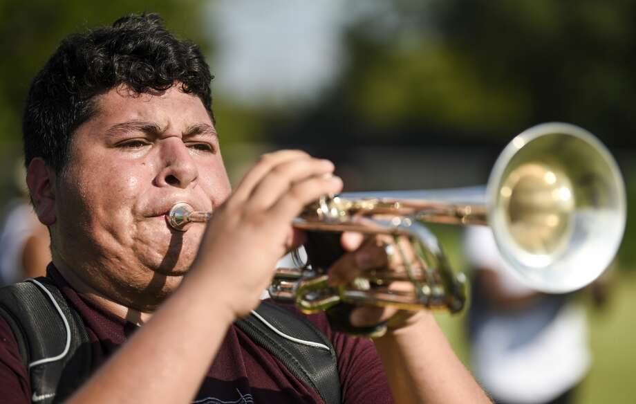 Christian Morales-Gracia plays the trumpet with other members of Beaumont United's band during practice Tuesday afternoon. Beaumont will see temperatures in the high 90's through the weekend. Photo taken on Tuesday, 09/04/19. Ryan Welch/The Enterprise Photo: Ryan Welch/The Enterprise