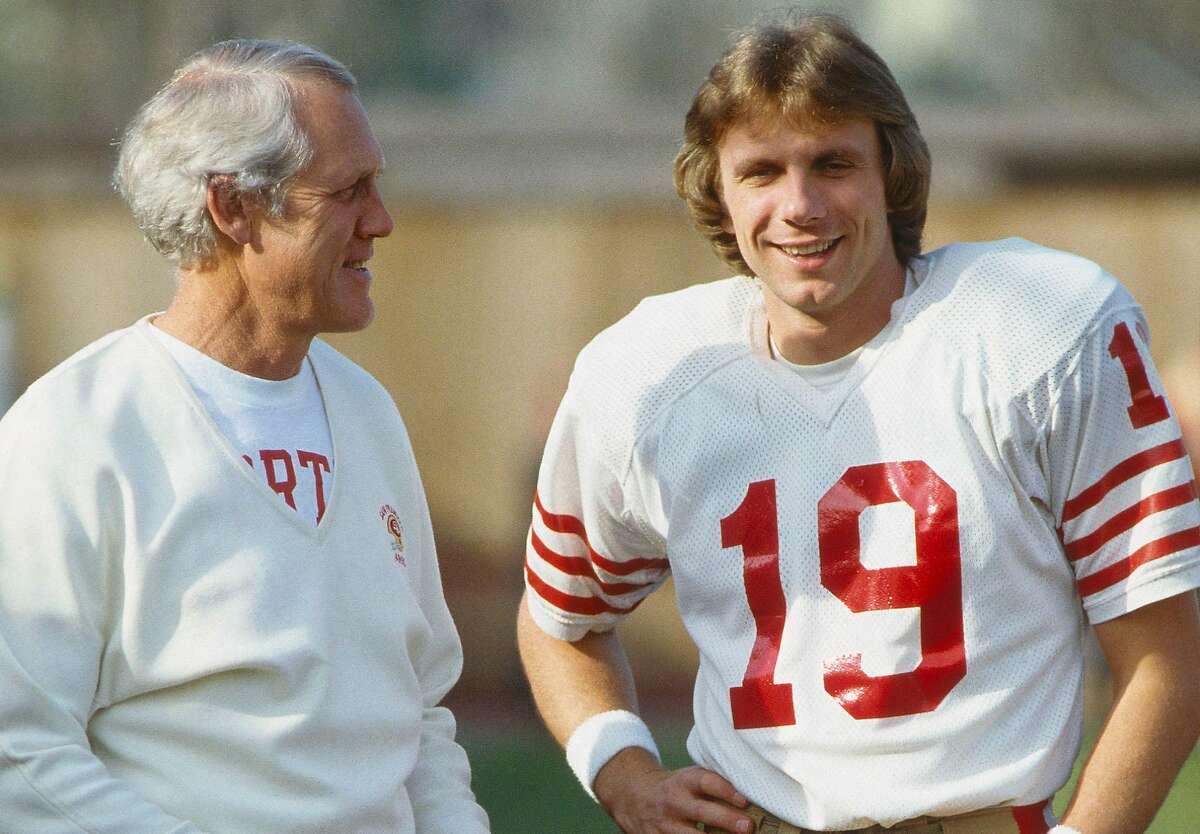 San Francisco 49ers' quarterback Joe Montana #19 talks to his coach, Bill Waish during the 1981 season. (Photo by Focus on Sport/Getty Images)