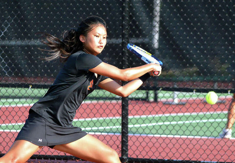 Edwardsville freshman Chloe Koons makes a backhand return during her No. 1 singles match Wednesday at St. Joseph's Academy.