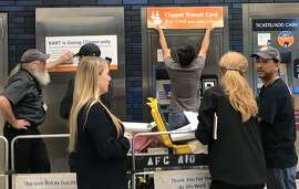Signs go up at 19th Street station in Oakland as BART phases out its paper tickets. When the paper tickets are gone, so is the Tiny Ticket program - and that's a loss for Bay Area charities, Caille Millner explains.