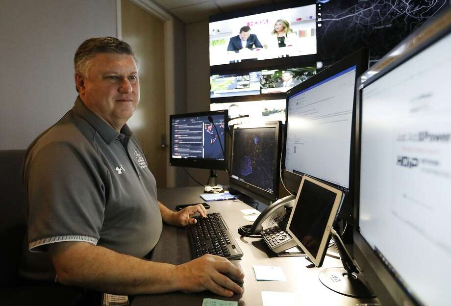 Paul Hildreth, emergency operations coordinator for the Fulton County School District, works in the emergency operations center at the Fulton County School District Administration Center in Atlanta. Artificial Intelligence is transforming surveillance cameras from passive sentries into active observers that can immediately spot a gunman, alert retailers when someone is shoplifting and help police quickly find suspects. Schools, such as the Fulton County School District, are among the most enthusiastic adopters of the technology. Photo: Cody Jackson / Associated Press