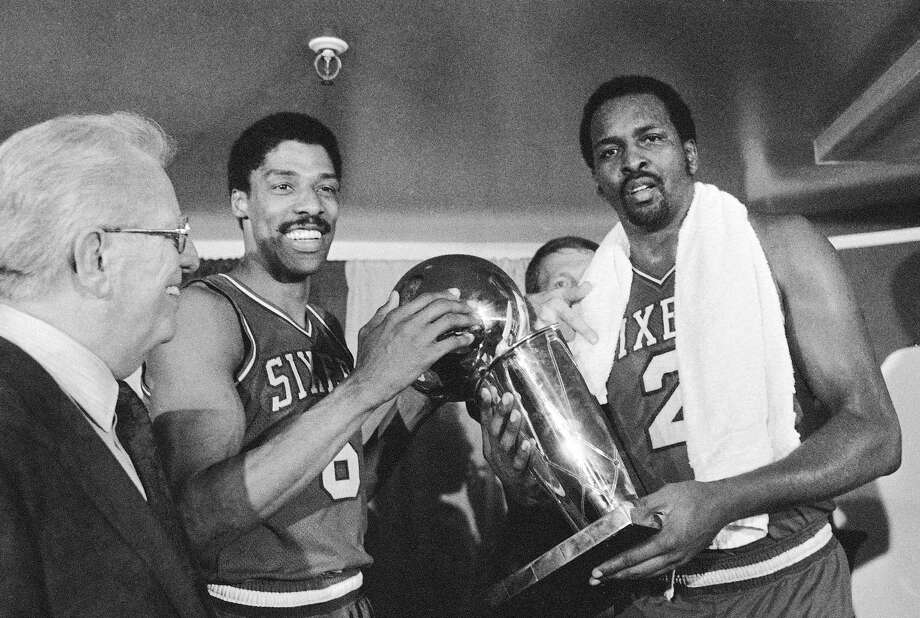 Philadelphia 76ers Julius Erving, left, and Moses Malone, right, hold the NBA Championship May 31, 1983 after defeating the Los Angeles Lakers in four straight games.  In the center background is 76ers coach Billy Cunningham.  At left is Basketball Commissioner Lawrence O'Brien.  (AP Photo) Photo: Anonymous, STF / AP / Internal