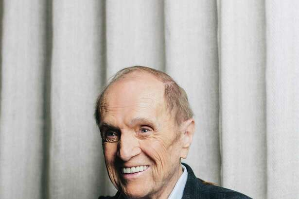 "The comedian Bob Newhart, at home in Los Angeles, Aug. 22, 2019. At 90, Newhart is still doing stand-up comedy, and thinking about the other side. ""What I'm actually hoping is there's the Pearly Gates and God's there and he says to me, ""What did you do in life?"" And I say, ""I was a stand-up comedian."" And he says: ""Get in that real short line over there."" (Alex Welsh/The New York Times)"