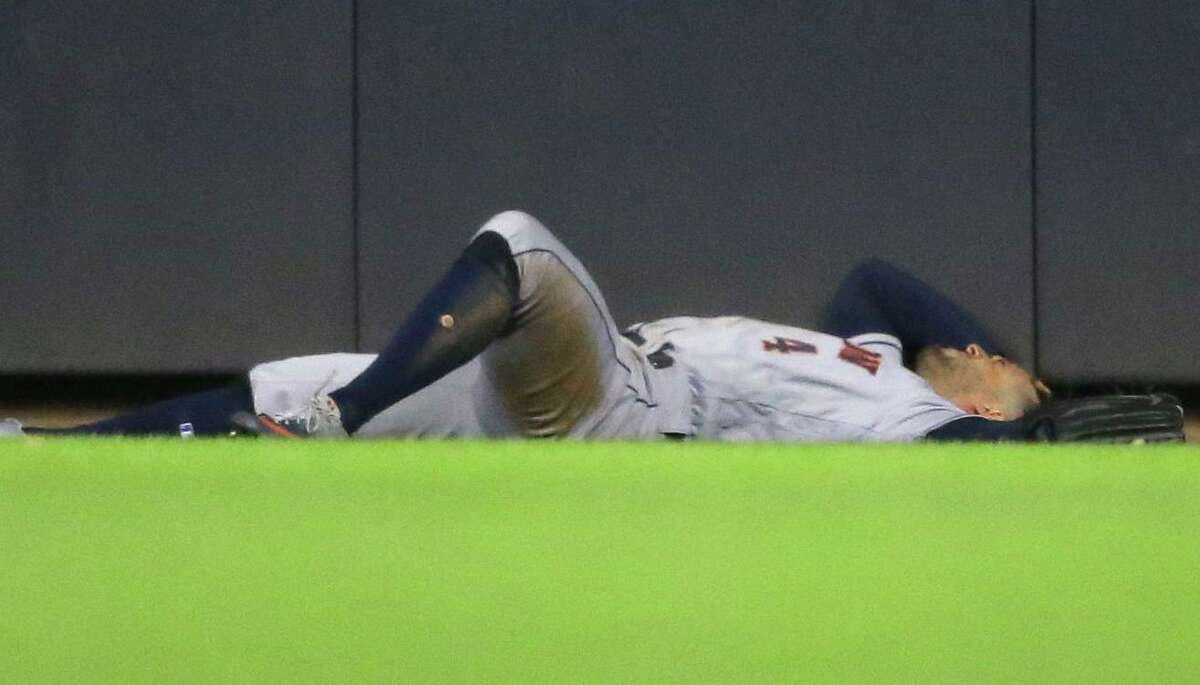 PHOTOS: Astros vs. Brewers After taking a tumble when he crashed into the center-field wall Tuesday night, George Springer was able to get up with the assistance of Astros trainer Jeremiah Randall and manager A.J. Hinch. >>>See photos from the Astros game against the Brewers on Tuesday ...