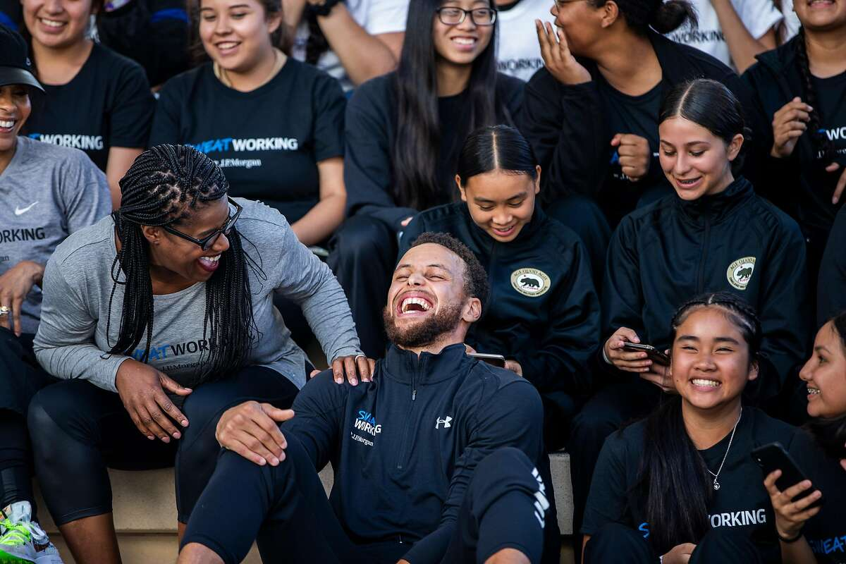 Stephen Curry of the Golden State Warriors shares a laugh with Chase CEO of Consumer Banking Thasunda Duckett during a Sweatworking event on girls� equity & equality and financial health at Chase Center Plaza in San Francisco, Calif. on Wednesday, Sept. 4, 2019.