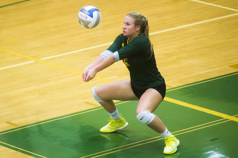 Dow High's Jenna Somers bumps the ball during a Sept. 20, 2018 game against Saginaw Heritage. Somers, who tore her ACL early last volleyball season, is back as the Chargers' senior libero this year. Photo: Daily News File Photo