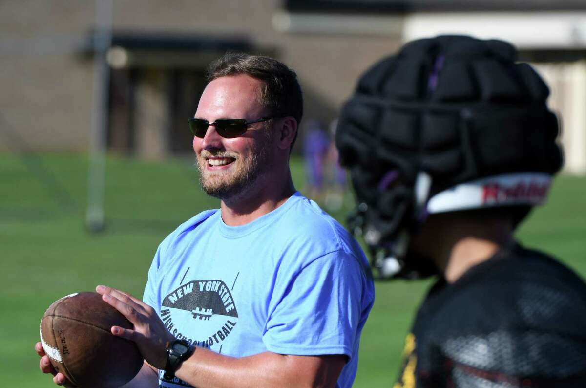 Ballston Spa varsity football coach Jason Ohnsman works with players during practice on Tuesday, Sept. 3, 2019, in Ballston Spa, N.Y. Ohnsman is a 29-year-old alum who played for the Scotties a decade ago. (Will Waldron/Times Union)