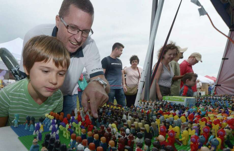 Frank Beust and his son Gabriel, 7, of Stamford look at GT Toys during The Norwalk Seaport Association 41rst Annual Oyster Festival Saturday, September 8, 2018, at Veterans Memorial Park in Norwalk, Conn. Photo: Erik Trautmann / Hearst Connecticut Media / Connecticut Post