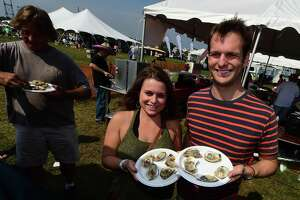 Olivia Gall and Wiull Geiger get ready to dig into their oysters during the 39th annual Norwalk Oyster Festival at Veterans Memorial Park Saturday, September 10, 2016, in Norwalk, Conn.