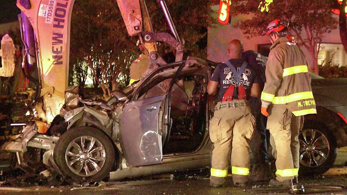 A woman crashed into a SAWS tractor overnight and almost suffered serious injuries if firefighters did not pull her out of her vehicle on time, San Antonio police said.