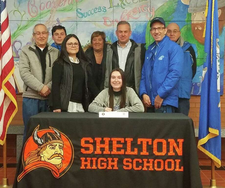 Maria Mandulak is surrounded by family and coaches when she signed a letter of intent to play women's tennis at Albertus Magnus College. Photo: Shelton High Athletics / Contributed Photo / Shelton Herald