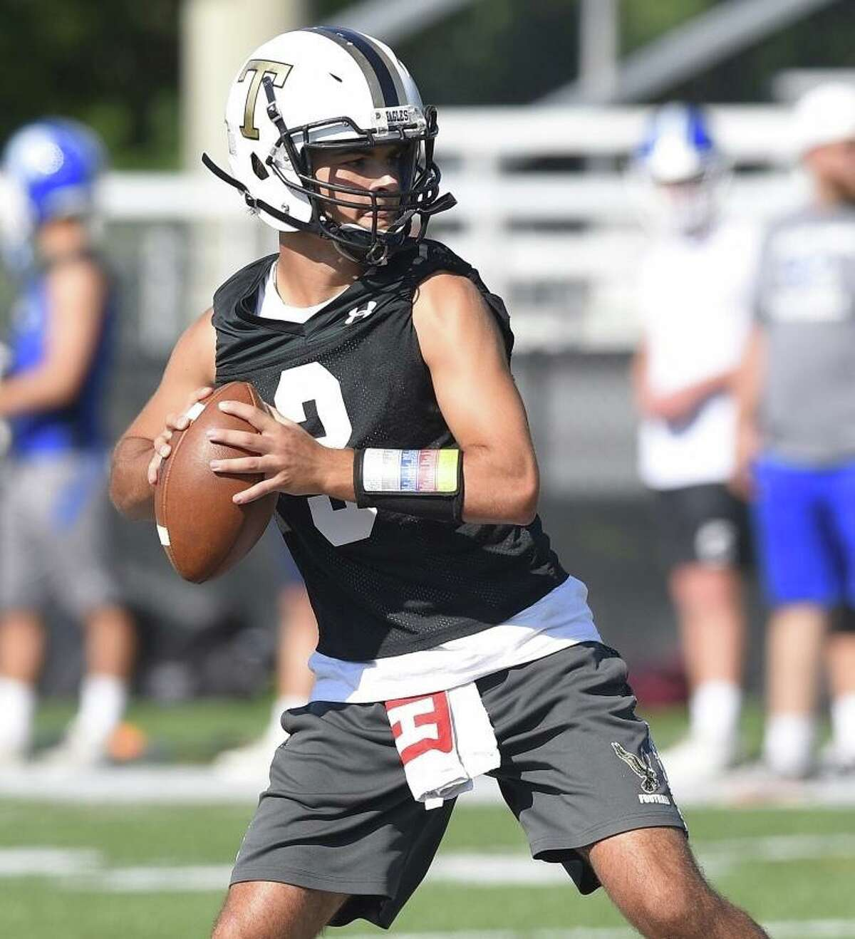 Trumbull quarterback Riley Simpson passes during the annual Rip It and Grip It tournament in summer 7-on-7 football scrimmages at New Canaan High School.