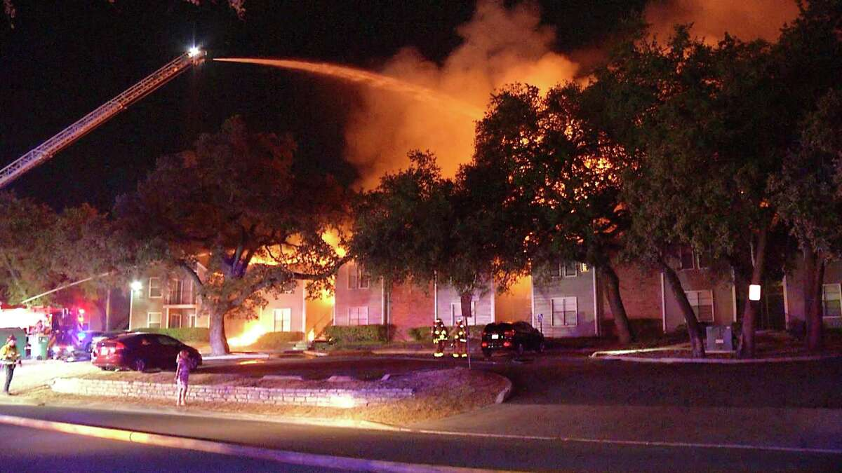 A three-alarm fire evacuated residents at an apartment complex on the city's Northeast Side late Wednesday evening, according to San Antonio Fire Department.
