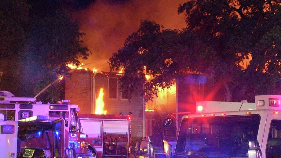 A three-alarm fire evacuated residents at an apartment complex on the city's Northeast Side late Wednesday evening, according to San Antonio Fire Department. Photo: Ken Branca
