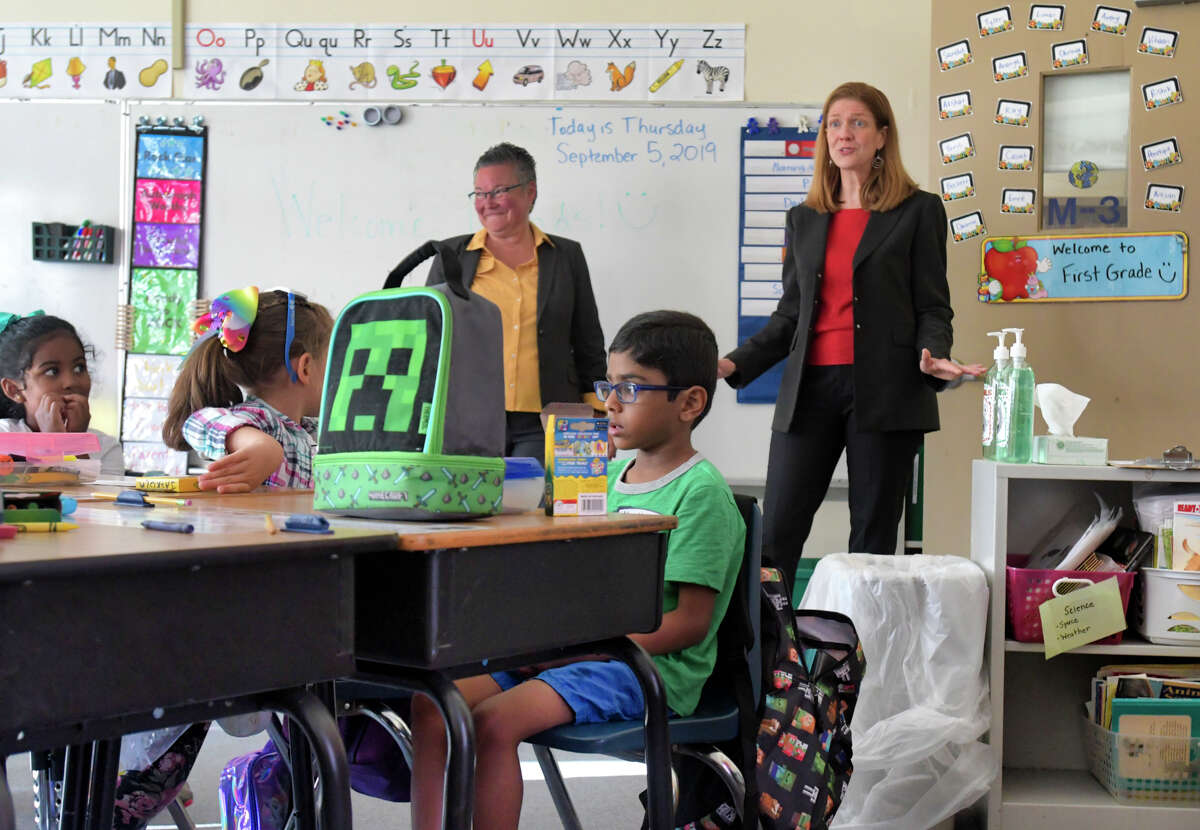Menands School District Superintendent Maureen Long, left, and New York State acting Education Commissioner Beth Berlin, right, visit students in a first grade class at Menands School on Thursday, Sept. 5, 2019, in Menands, N.Y. (Paul Buckowski/Times Union)