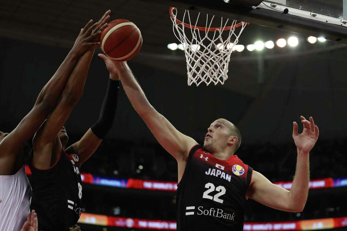 Japan's Nick Fazekas reaches for the ball during a Group E match for the FIBA Basketball World Cup at the Shanghai Oriental Sports Center in Shanghai on Thursday, Sept. 5, 2019.