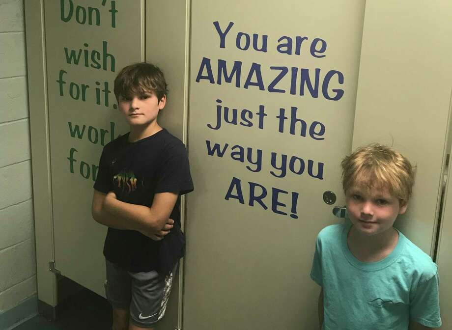Farmingville Elementary School students Harrison Wilson and Derik Wilson inside the school's updated bathrooms. Photo: Contributed Photo