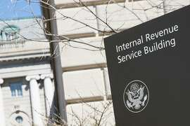 A logo sign outside of the headquarters of the Internal Revenue Service (IRS) in downtown Washington, D.C., on March 31, 2018. The Internal Revenue Service warns that crooks may try to use your bank account as part of a complicated scheme involving tax fraud. (Kristoffer Tripplaar/Sipa USA)