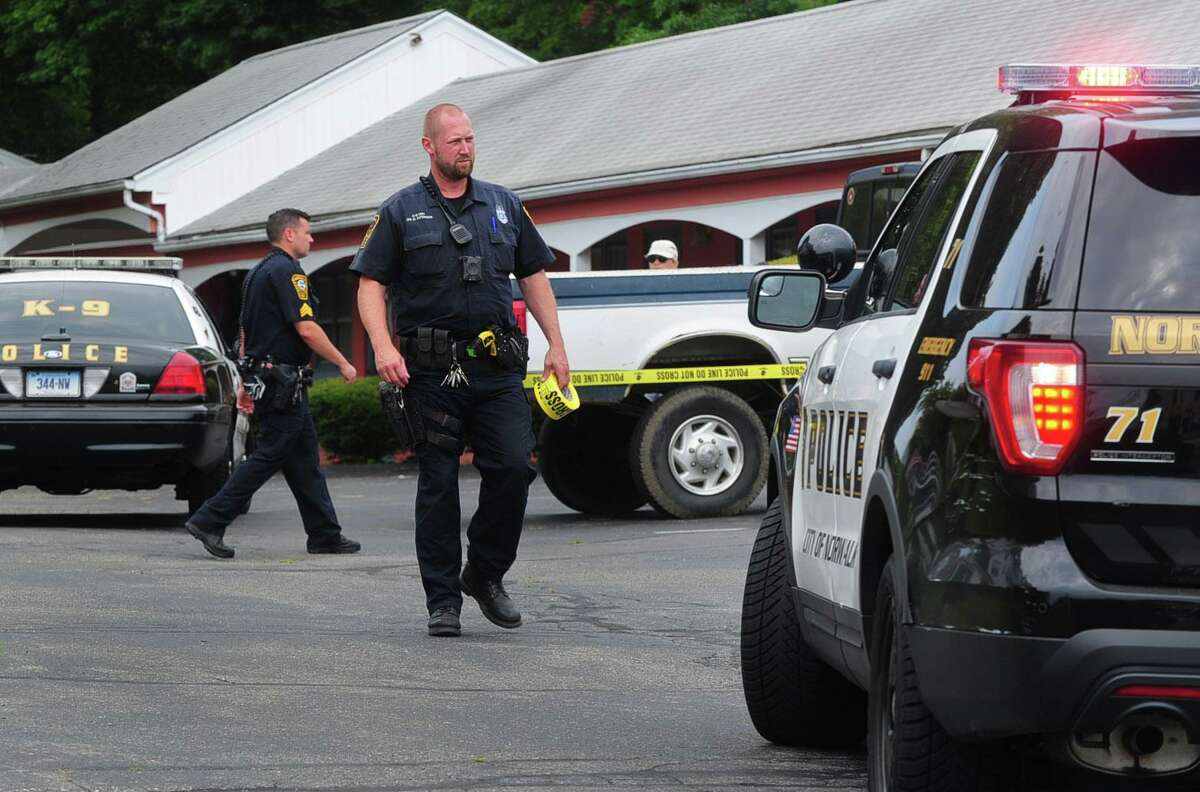 Norwalk police respond to a reported drug overdose Saturday, July 22, 2017, at the Garden Park Motel on Westport Avenue in Norwalk, Conn.